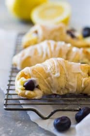These Lemon Blueberry Cheesecake Crescent rolls is an easy recipe using store bought crescent dough. Combine that with lemon and blueberries and you have one sweet treat!