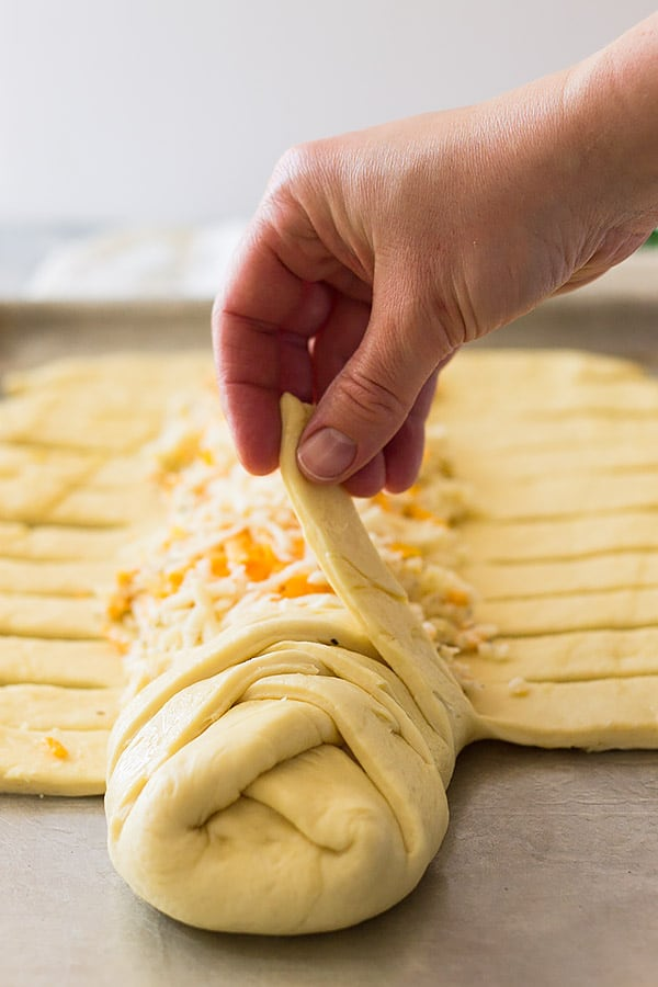 Three cheese braid showing how to braid the dough.