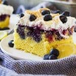 This Lemon Blueberry Poke Cake is perfect for spring and summer! It's make with a lemon cake then drizzled with lemon curd and a blueberry syrup.
