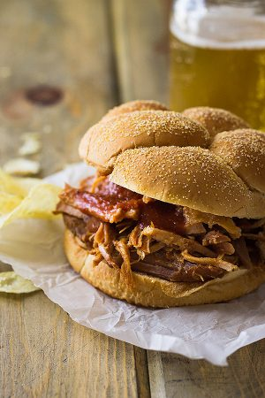 This slow cooker bbq pulled pork is made easy in the crock pot. It's full of flavor and loads of bbq sauce.