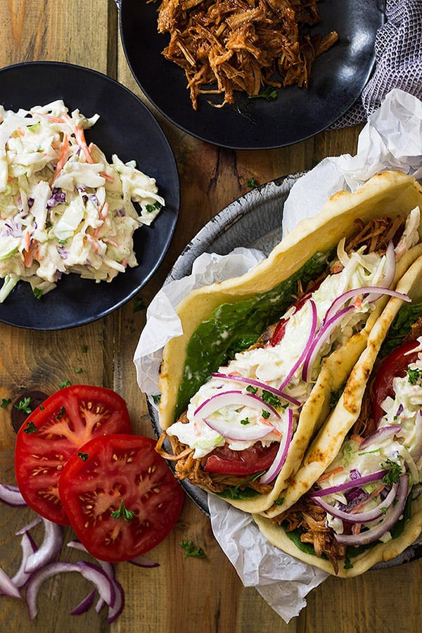 These BBQ Pulled Pork Gyros are a great way to use up some pulled pork. Top them with some homemade creamy coleslaw and bbq sauce and you have one delightful sandwich.