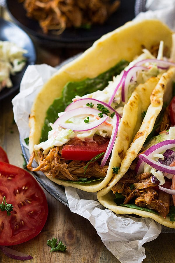 These BBQ Pulled Pork Gyros are filled with a slow cooker pulled pork, homemade creamy coleslaw and bbq sauce and all rolled into a nice warm flatbread. YUM!!