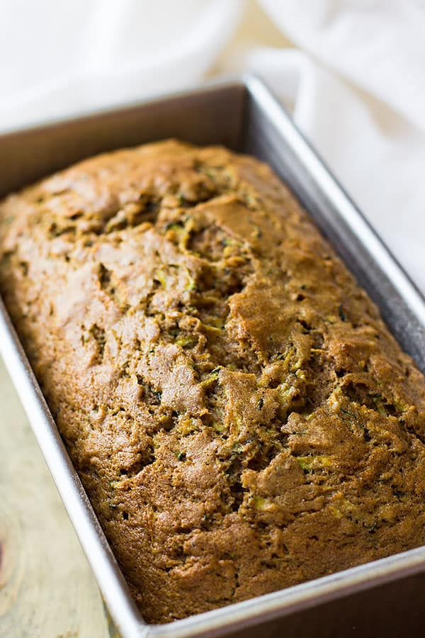 An easy zucchini quick bread recipe that is full of fresh zucchini, cinnamon and clove. Your house will smell amazing!