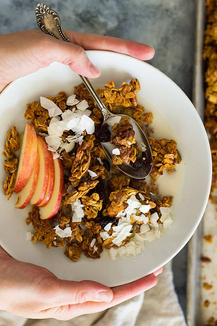 This Crunchy Pumpkin Granola is filled with warming fall goodness! It's make with real pumpkin, nuts, dried fruit and naturally sweetened.