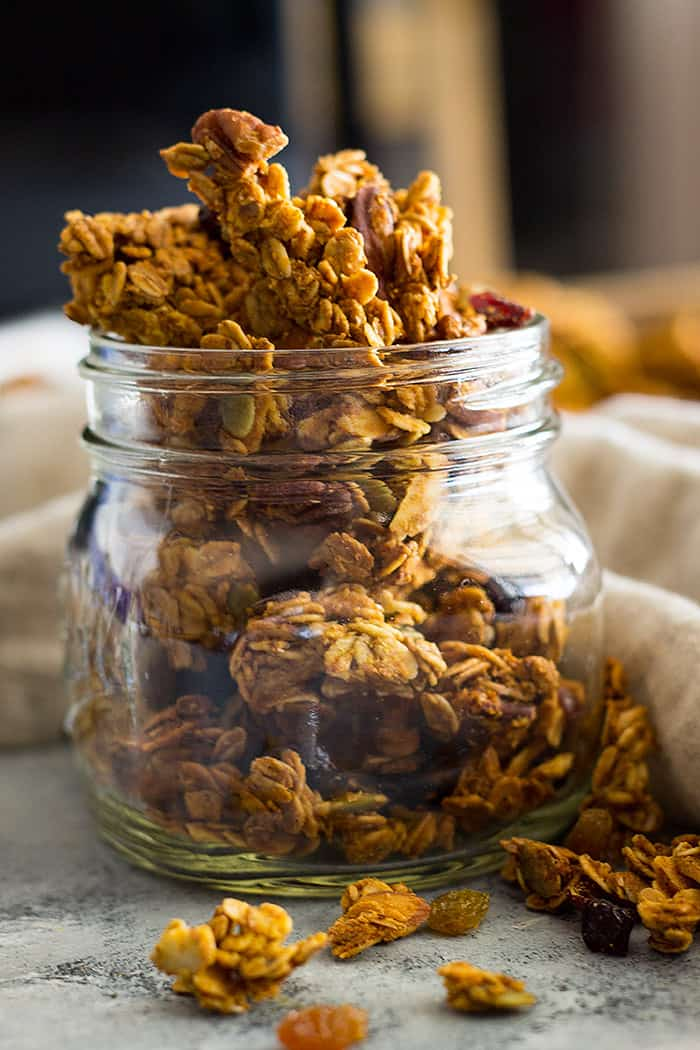 This Crunchy Pumpkin Granola is healthy and delicious! It's made with real pumpkin, coconut oil, dried fruit, nuts and seeds!