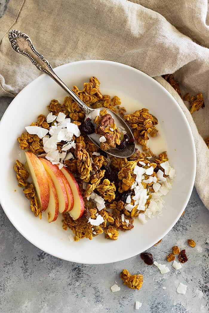 This healthy Crunchy Pumpkin Granola is naturally sweetened and made with real pumpkin. It's easy to make and is great for breakfast!