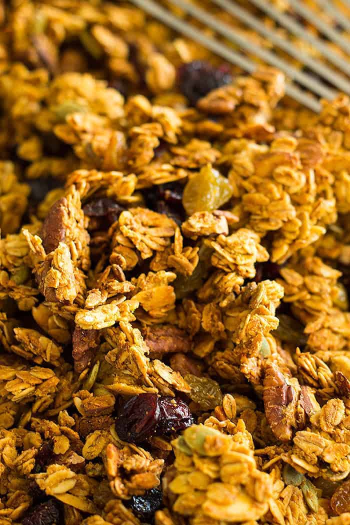 This easy and healthy Crunchy Pumpkin Granola is made with real pumpkin! It has tons of fall goodies like pecans, pumpkin spice and pumpkin seeds!