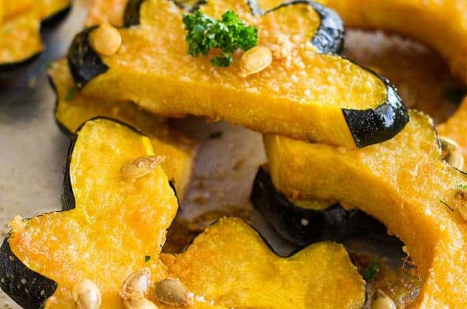 This Parmesan Roasted Acorn Squash is an easy savory side dish. It uses simple ingredients and even roasts the seeds!