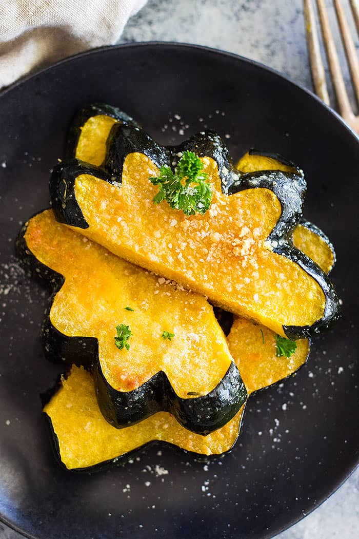 This simple Parmesan Roasted Acorn Squash is an easy side dish. It uses just a few simple ingredients and you can even roast the seeds!