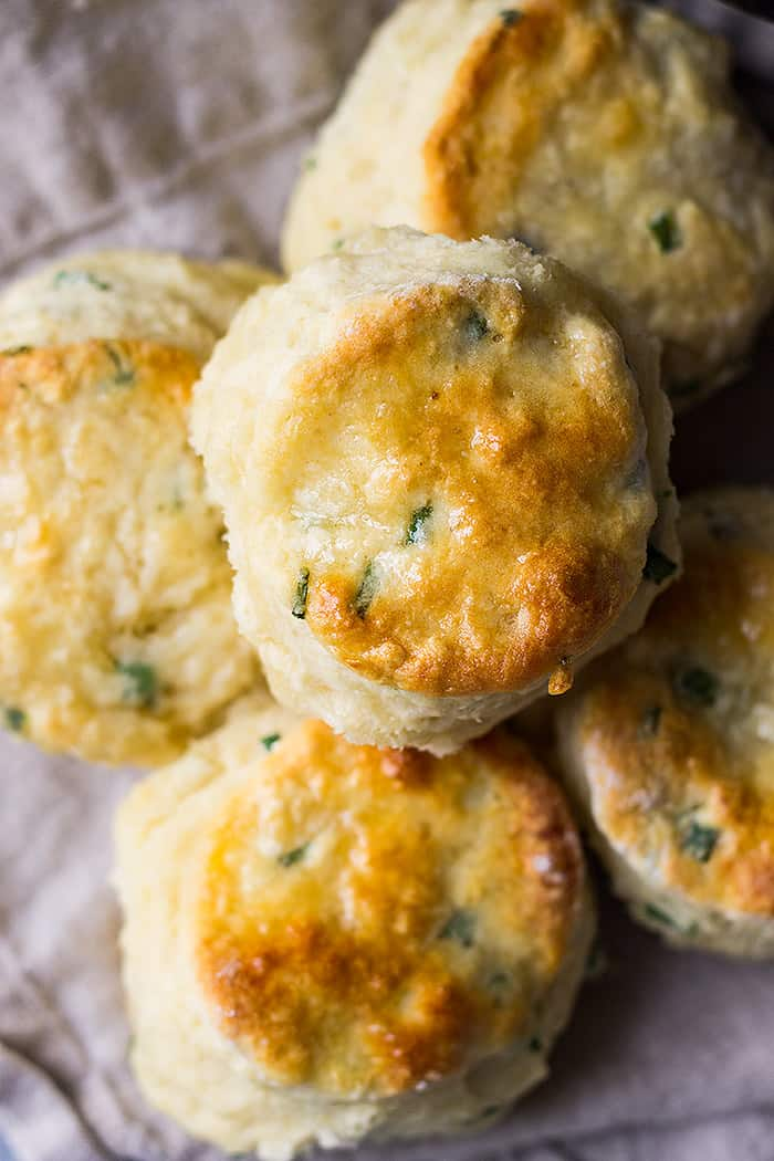 These Buttermilk Chive Biscuits are extra special and easy to make! They are soft, tall, buttery and go great with breakfast or dinner!