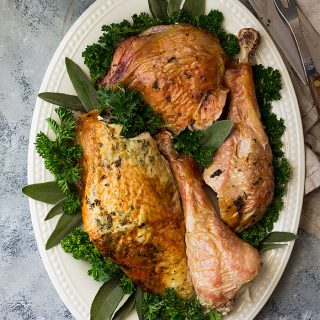 This Butterflied Roasted Herb Turkey (spatchcocked) is the best way to roast a bird! It produces crispier skin and juicier meat in a lot less time than the traditional way!