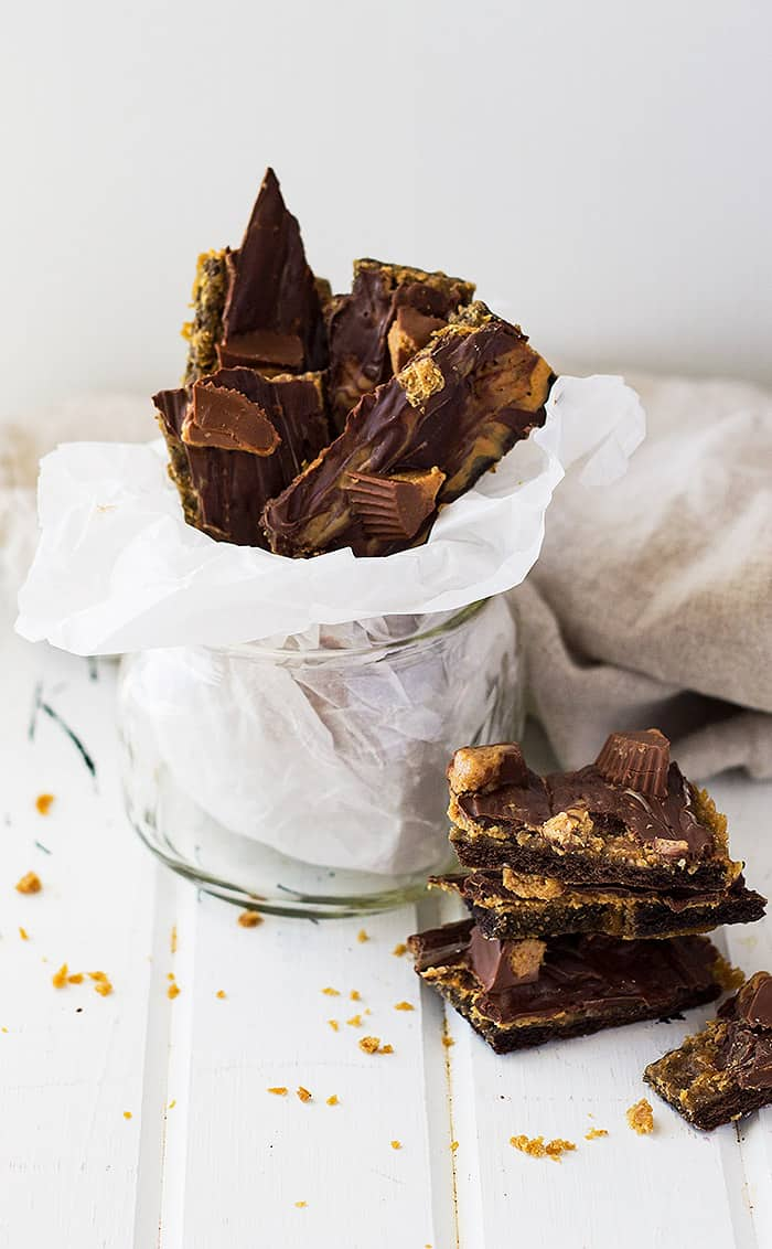 This Peanut Butter Cup Graham Cracker Toffee is crunchy, swirled with peanut butter, then topped with peanut butter cups!