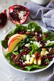 This Spinach, Apple, and Pomegranate Salad is packed with nutrition and full of crunch! Plus, it makes a beautiful salad to look at!