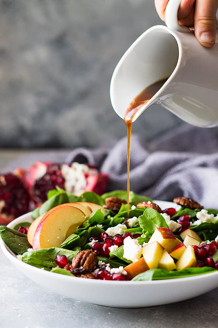 This Spinach, Apple, and Pomegranate Salad is packed full of crunch and nutrition! It's a healthy salad that tastes phenomenal and makes a beautiful presentation.