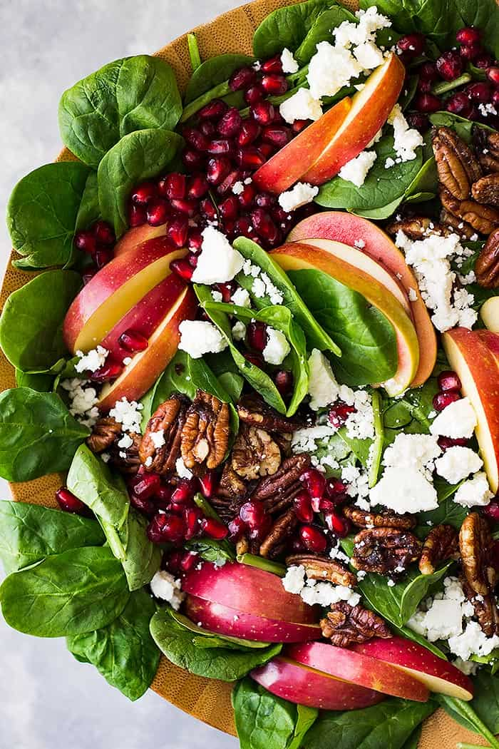 This Spinach, Apple, and Pomegranate Salad makes an impressive presentation! Plus, it's packed with nutrition and full of flavor and crunch!