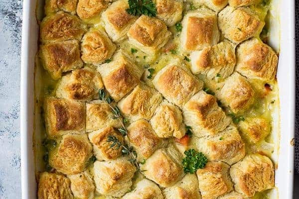 This homemade Chicken Pot Pie with Biscuits is a great way to use leftover chicken, turkey, herbs and veggies you may have hiding in the back of your fridge!