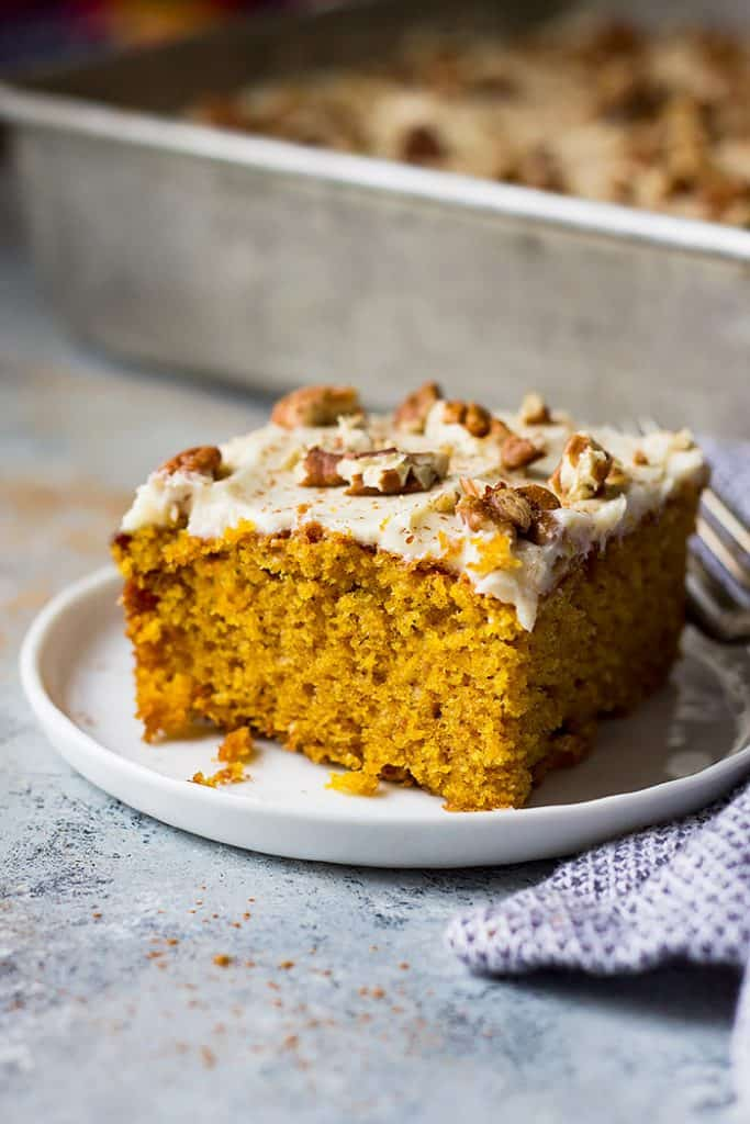 This moist and delicious Easy Pumpkin Cake with Cream Cheese Frosting is the perfect fall dessert! It's tastes like a pumpkin cake roll only easier!
