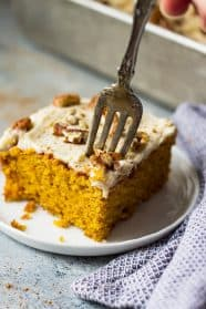 This Easy Pumpkin Cake with Cream Cheese Frosting is a lot easier than a pumpkin cake roll but tastes just like it! It's moist, full of pumpkin spice, topped with a dreamy cream cheese frosting and perfect for fall!