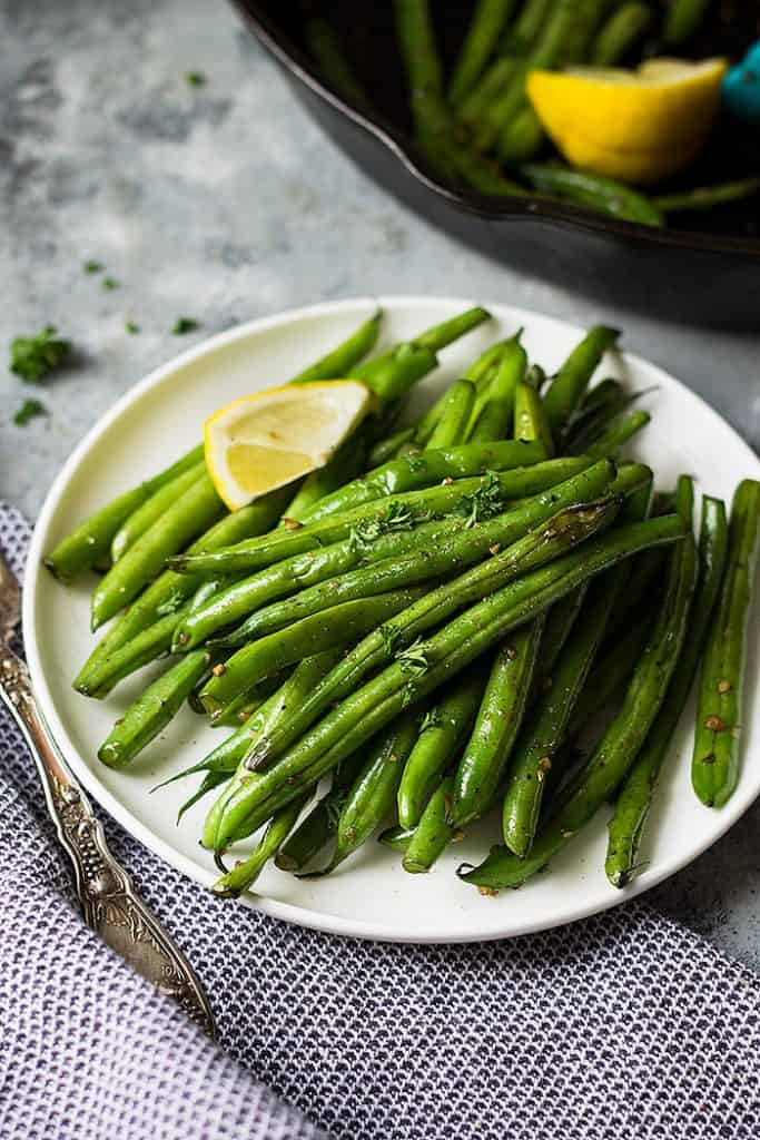 This Skillet Garlic Green Beans are the perfect healthy side dish! Plus, they are quick and simple to make!