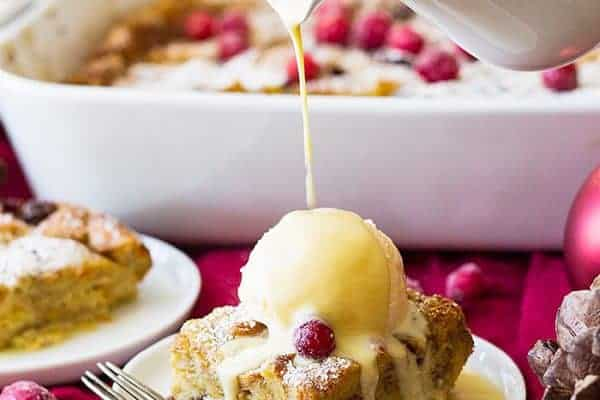 This Cranberry Bread Pudding with Whiskey Cream Sauce is an indulgent dessert! Brioche bread baked in a cinnamon custard then topped with a whiskey cream sauce!