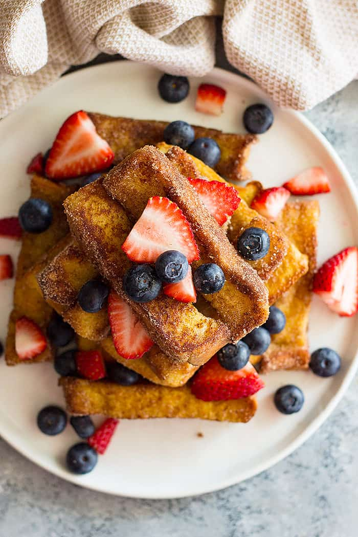 Cinnamon Sugar French Toast Sticks - a wonderful special occasion breakfast that's fun! Baked or fried they are great to make ahead and have on hand!