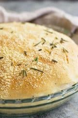 Close up of a round loaf of rosemary parmesan bread.