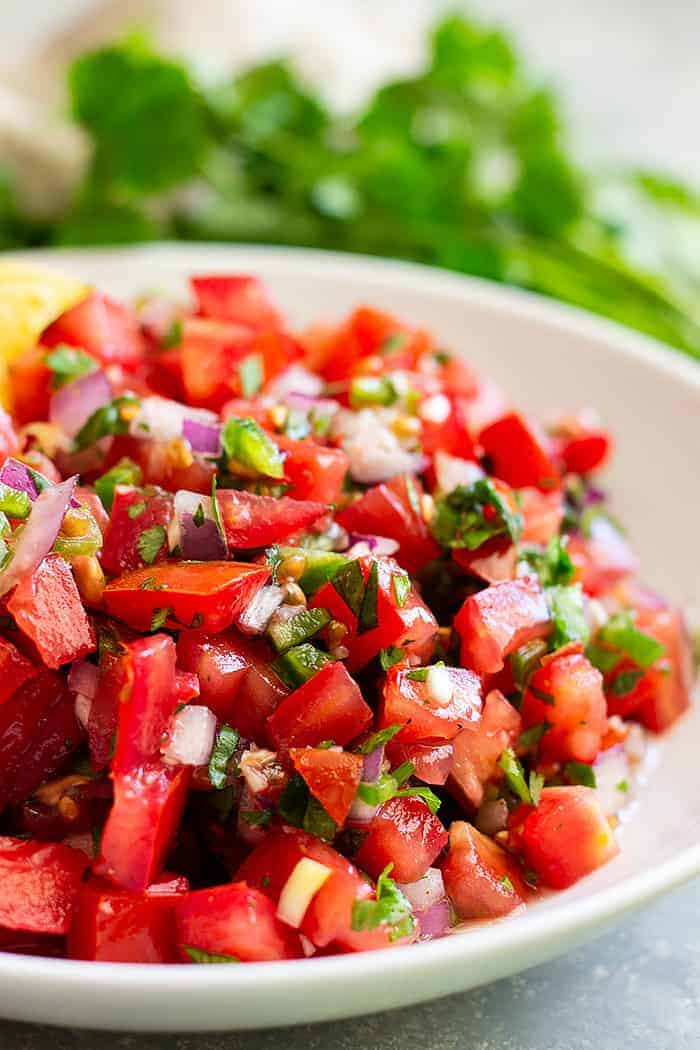 Close up view of Homemade Pico de Gallo in a bowl.