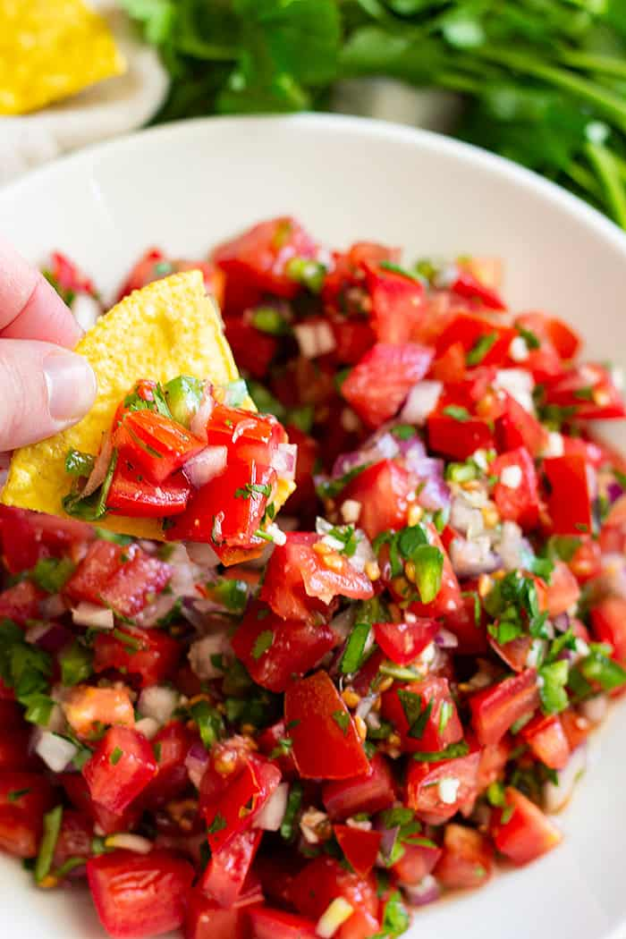 How to make Homemade Pico de Gallo -a simple and fresh salsa. Make this as chunky or smooth as you like and as spicy or mild as you like.