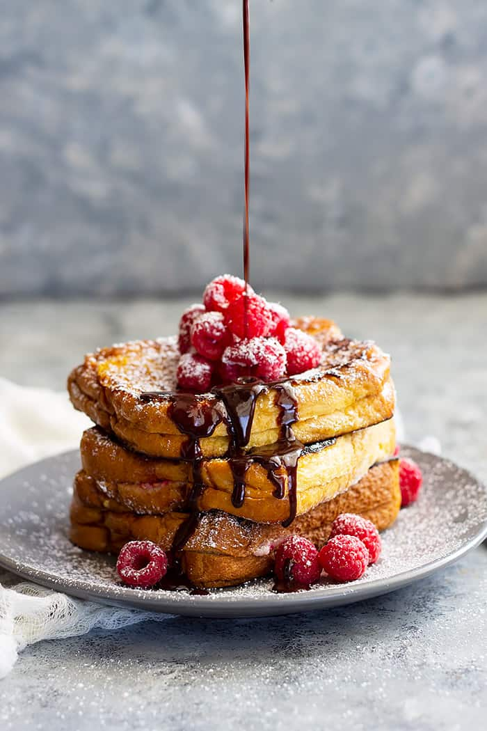 Raspberry Cheesecake Stuffed French Toast -rich and buttery brioche bread stuffed with raspberry cheesecake filling. Drizzle with a little hot fudge sauce and you have a very special breakfast or brunch!