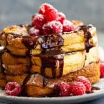 Raspberry Cheesecake Stuffed French Toast -is a very special brunch or breakfast! Buttery brioche bread stuffed with raspberry cheesecake filling then drizzled with hot fudge sauce! It's like dessert for breakfast!