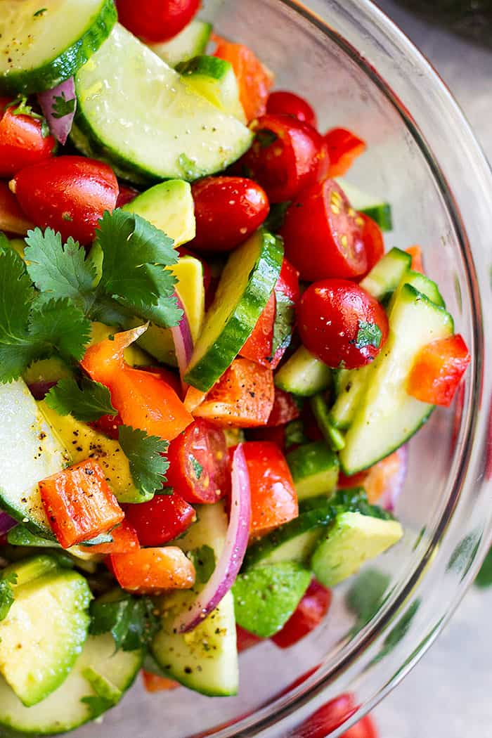 Tomato Cucumber and Avocado Salad -is a light, fresh, and flavorful salad. It's quick and easy to make and super healthy to eat!