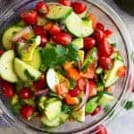 Tomato Cucumber and Avocado Salad -is an easy salad that's light, fresh, full of flavor, and perfect for summer! It's super quick to make and healthy to eat!