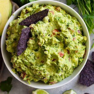 Homemade Guacamole Recipe -is a quick and easy recipe that's great for any party! It's healthy, great to dip chips or vegetables in, and it's great with any Mexican dish!