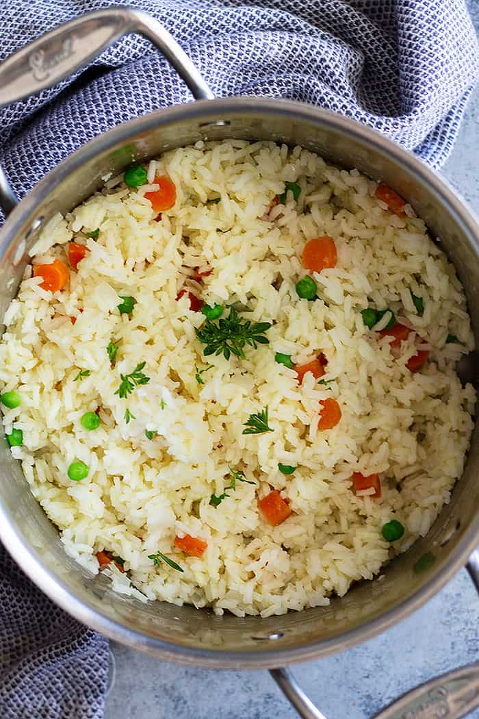 This Easy Rice Pilaf with Carrots and Peas is a staple recipe everyone should learn how to make. It's so easy to make, goes great with so many dishes, and you can easily make it your own.