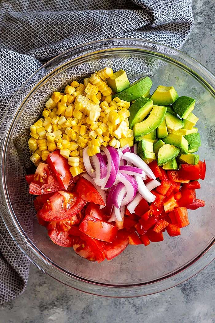 This Grilled Corn Salad with Tomato and Avocado is great paired with BBQ chicken, pork, seafood, or beef! It's the perfect summer salad! #salad #summer #healthy #glutenfree