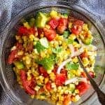 This Grilled Corn Salad with Tomato and Avocado is a healthy side dish that's great for a summertime BBQ! It's also great for a quick light lunch! #salad #summer #healthy #glutenfree