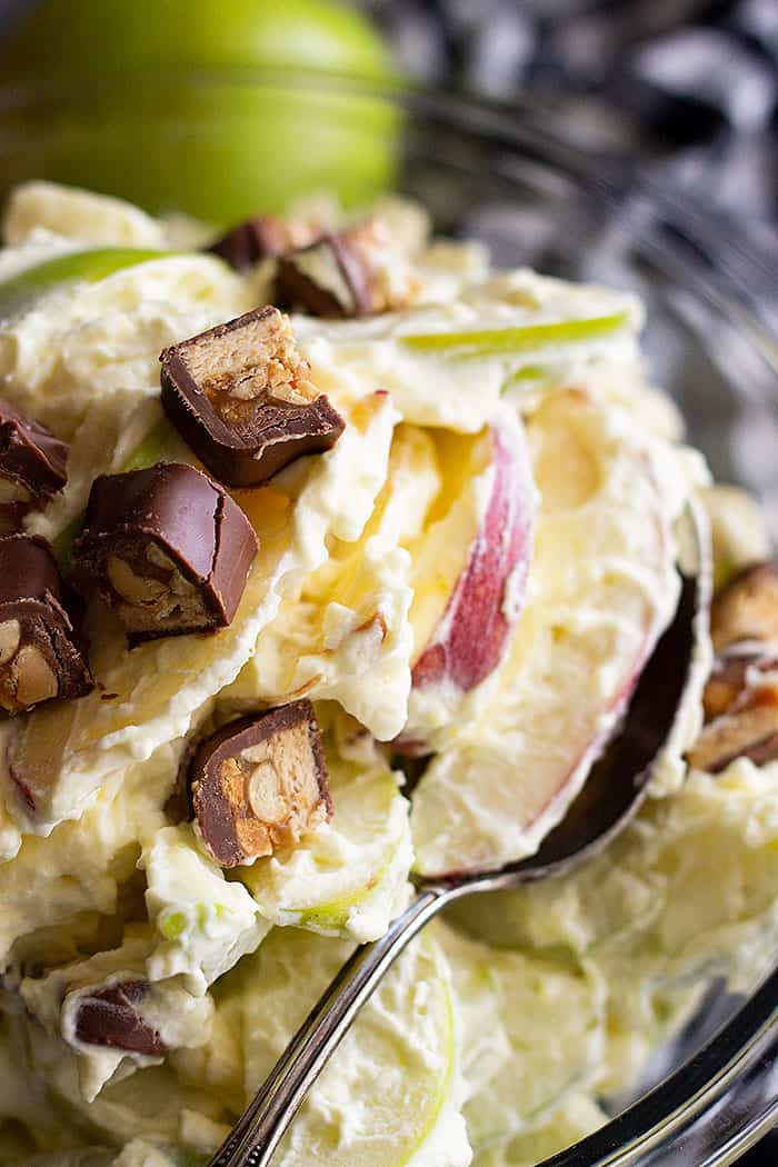 This Snickers Apple Salad is a super easy dessert salad that's great to take to potlucks, picnics, and family gatherings! It's guaranteed to be the first to go! #apple #easyrecipe #dessert #coolwhip