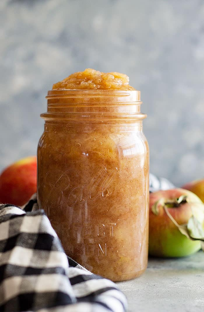 Easy Homemade Applesauce that is perfectly spiced and so comforting! Directions for slow cooker, instant pot, and stove top! It's a healthy snack that is sugar free, full of fiber, and flavor! #apple #applesauce #easyrecipe #homemadeapplesauce