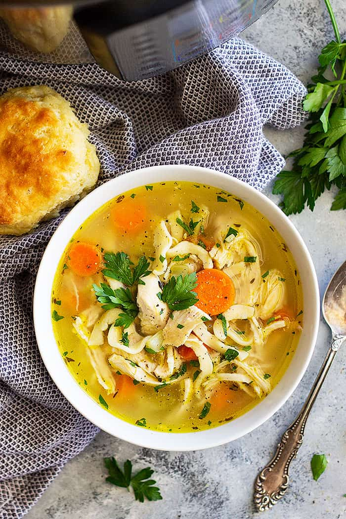 Need a comforting bowl of chicken noodle soup? This Instant Pot (Pressure Cooker) Chicken Noodle Soup is easy to make and full of flavor. And thanks to the Instant Pot it's ready in a fraction of the time! #chicken #chickennoodlesoup #instantpot