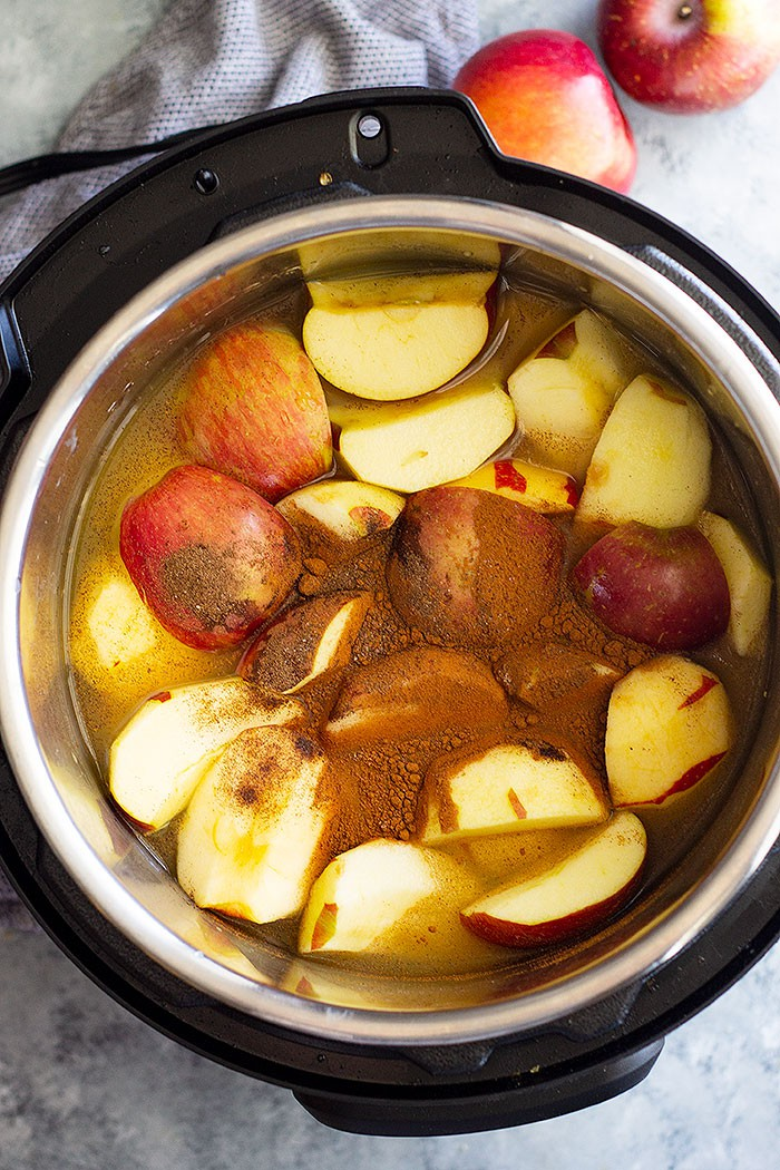 Homemade Apple Cider that's filled with warm spices like cinnamon, allspice, and a little clove. It's the perfect drink to warm up with! Slow cooker, Instant Pot, and stove top instructions included. #apples #applecider #easyrecipe #beverage