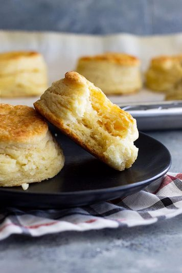 How to make flaky buttermilk biscuits. This guide will show you everything to make fluffy, buttery, flaky biscuits. #homemadebiscuits #buttermilkbiscuits #bread #biscuitrecipe