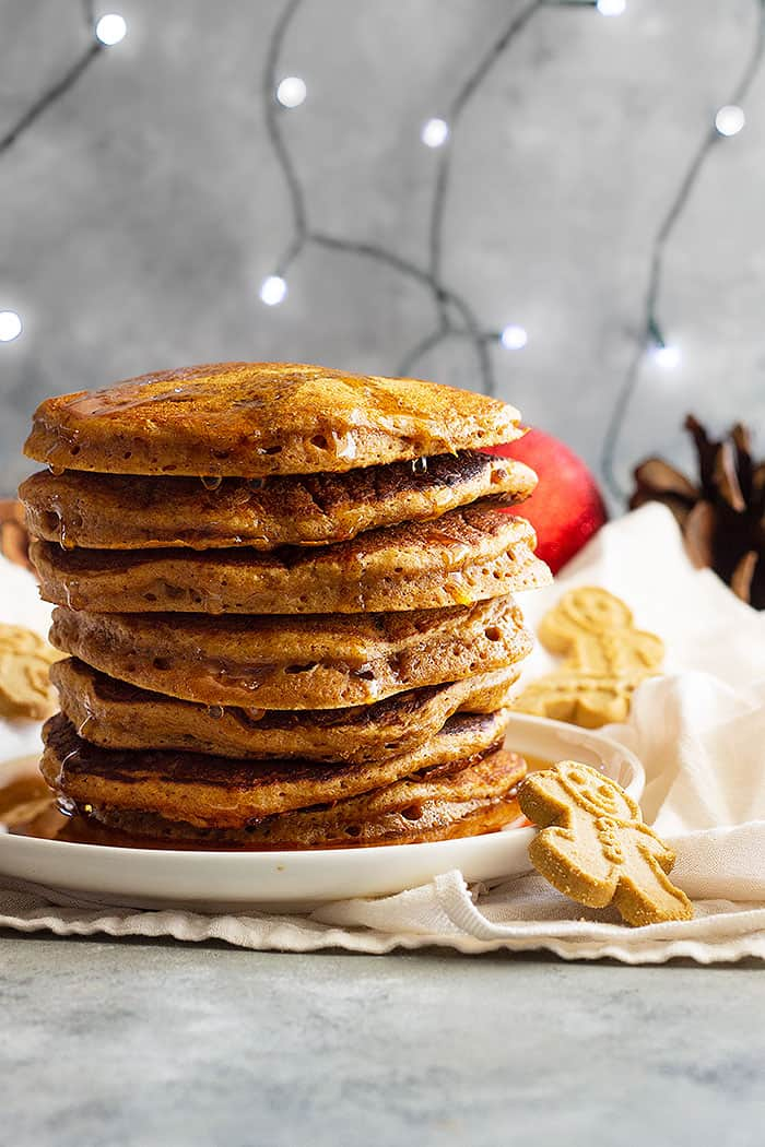 These soft and fluffy Gingerbread Pancakes are spiced just right and taste like a gingerbread cookie!! These will make the perfect Christmas morning breakfast!! #gingerbreadpanckes #christmasmorningbreakfast