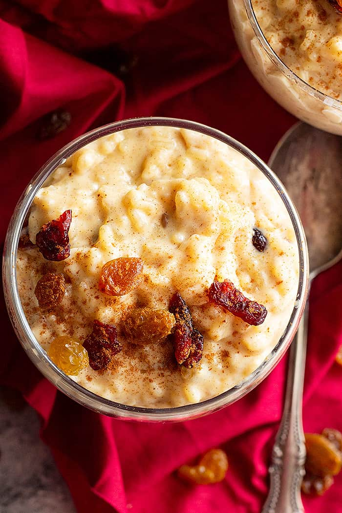 This Creamy Rice Pudding is a simple rice pudding made on the stovetop. With a touch of cinnamon, vanilla, and raisins this isn't just a boring rice pudding! #ricepudding #homemadericepudding