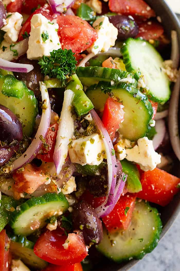 This Easy Greek Salad is a refreshing and satisfying salad. It's full of flavor and crunch and if you're tired of spinach or kale this is a great healthy option to change it up! #greeksalad #healthysalad