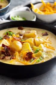 This Creamy Potato Soup is made with no cream soup just easy simple ingredients! It's comfort food that can be on your table in under 30 minutes! #comfortfood #potatosoup