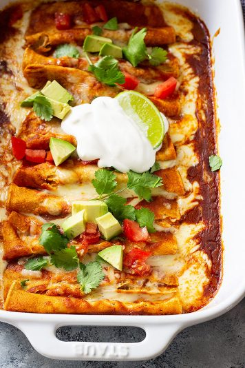 These Cheese Enchiladas are corn tortillas filled with monterey jack cheese and topped with a homemade red enchilada sauce! They are easy to make and will become a family favorite! #redenchiladas #cheeseenchiladas