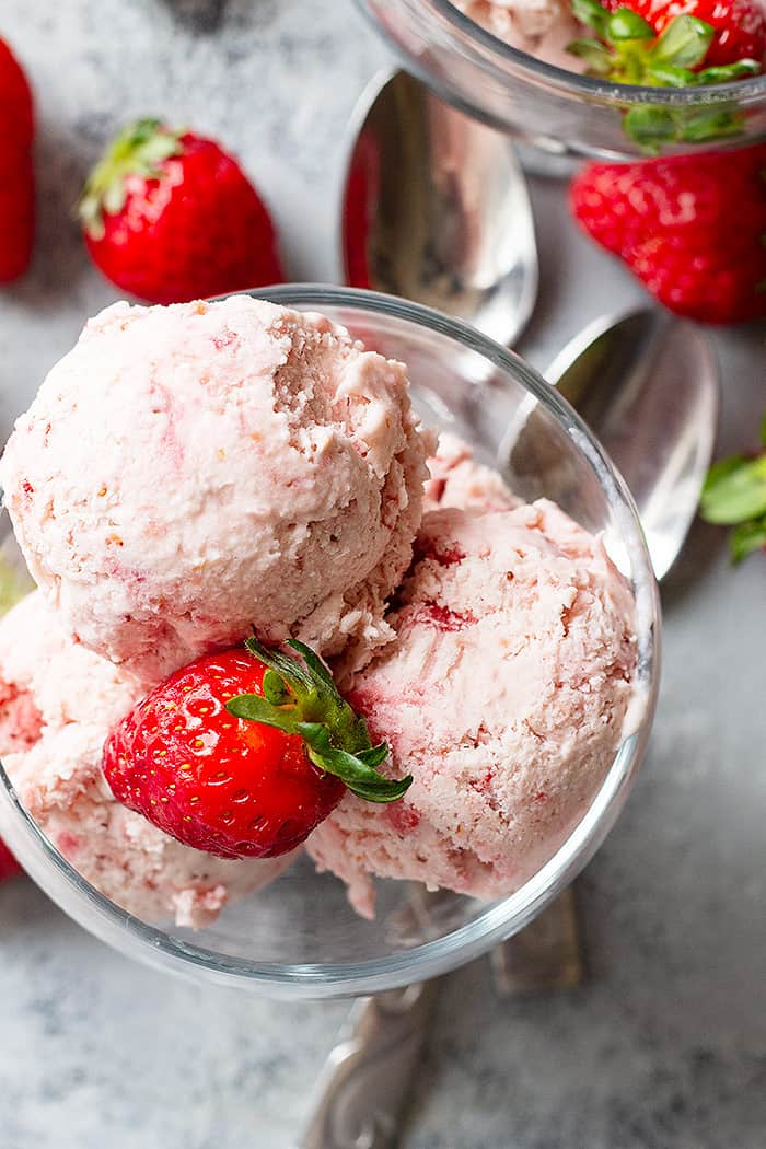 This No Churn Strawberry Ice Cream is so easy to make! No ice cream maker needed and no cooking! #strawberryicecream #nochurnicecream