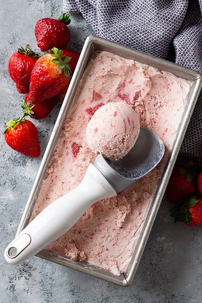 This easy No Churn Strawberry Ice Cream requires no cooking or churning! It's creamy, smooth, and delicious! #nochurnicecream #strawberryicecream