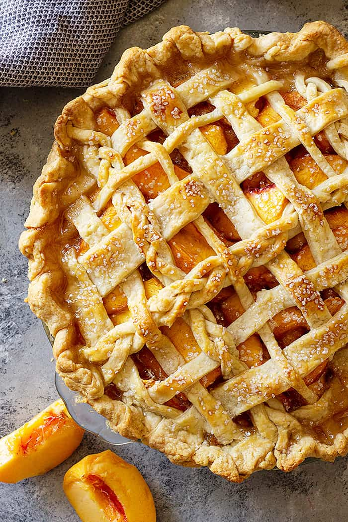 Close up of baked peach pie.
