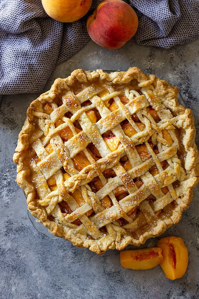 Freshly baked peach pie with an all butter pie crust.
